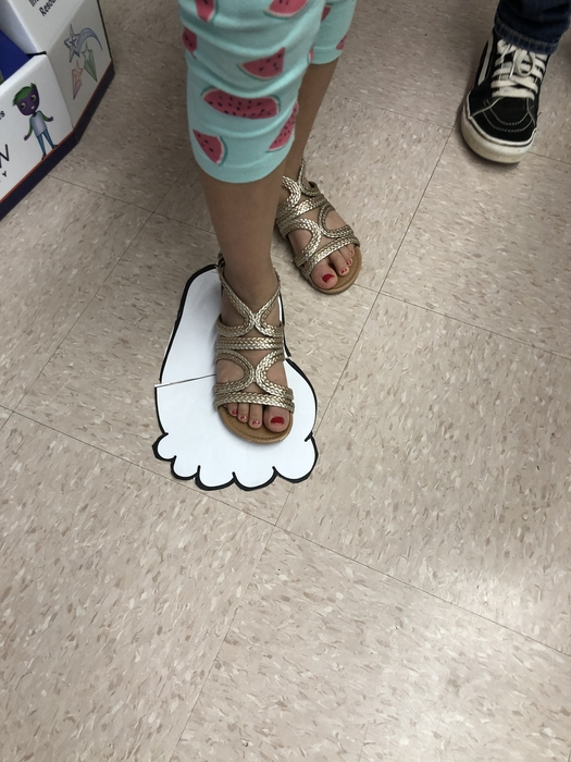 "Comparing a second grader's foot to one that is 12"" long."