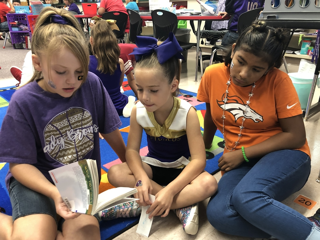 Second graders and fifth graders buddy reading