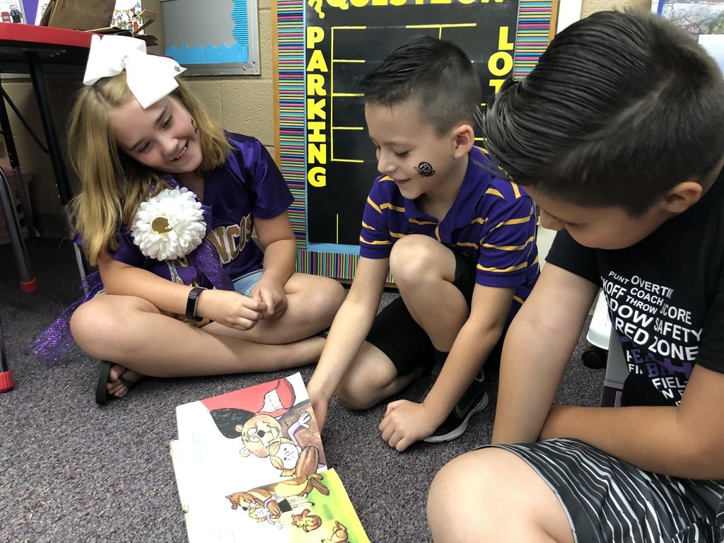 Second and fifth graders buddy reading